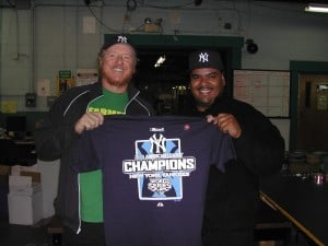 Two happy screenprinters (and Yankee fans), tired but happy after printing Yankee ALCS shirts all night