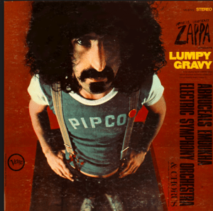 Zappa in an obscure company softball company shirt, with the ink somewhat washed off.