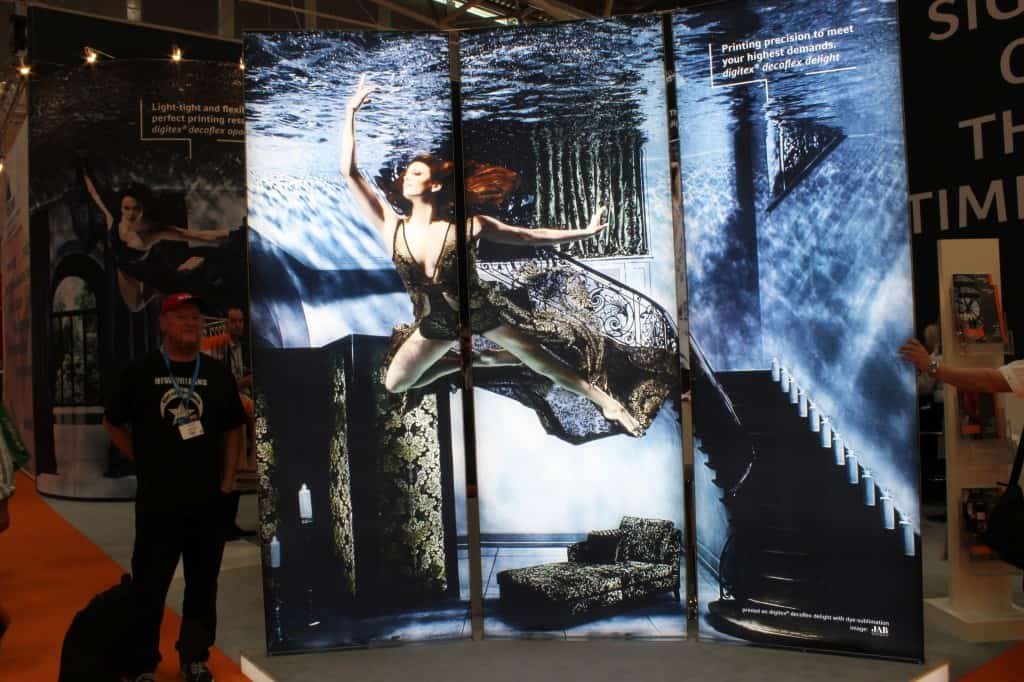 Striking image in a booth selling substrates for sublimation for signs.