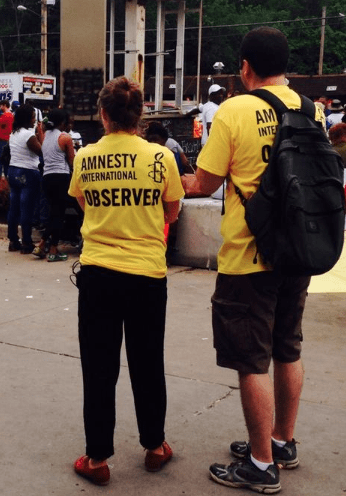Bright Yellow Amnesty International Observer Shirts