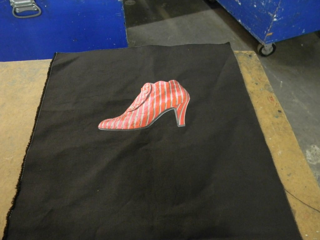 Another example of canvas printed before assembling the bag. In this case we printed 300 shirts and 300 bags and they could be printed at the same time. With a finished bag you would have to take the screens down and turn them around since  a shirt loads on the machine from the bottom and a bag loads from the top.