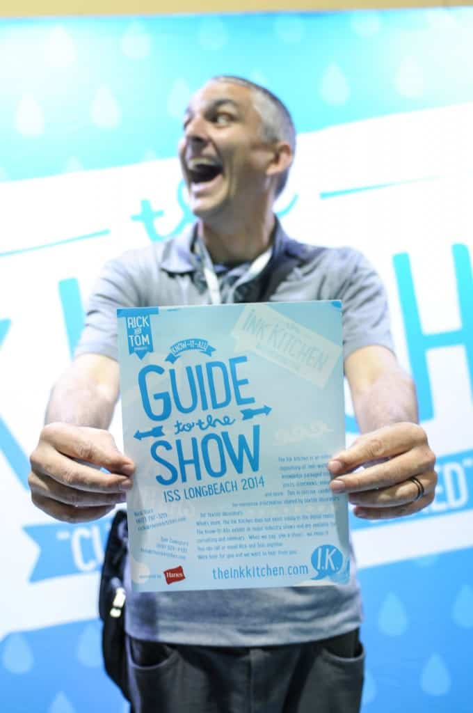 "Some happy dude that stopped by our booth and grabbed our guide to the show. Check out our ""Who We Work with and Why"" section. If we don't already use their products we do NOT allow anyone to sponsor The Ink Kitchen"