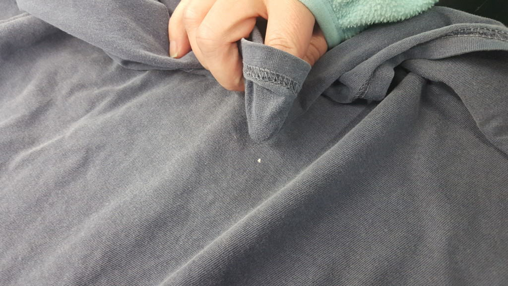 Even more rarely you can cover a tiny spot by rubbing the inside of the shirt on it